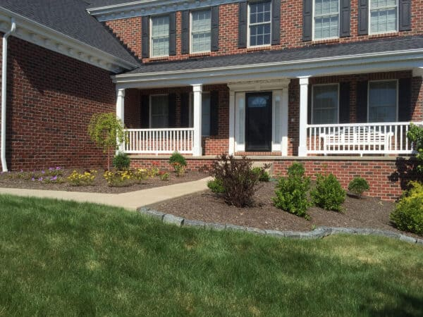 Beautifully Manicured Lawn with Red Brick Home