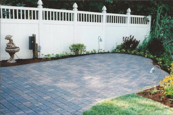 Stone Patio with a White Fence