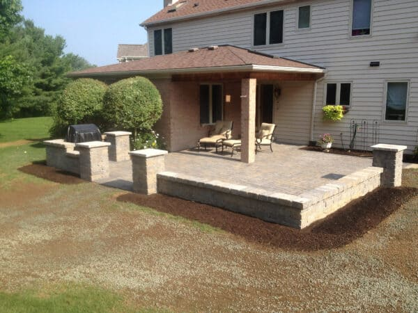 Modern Stone Patio with Stone Wall