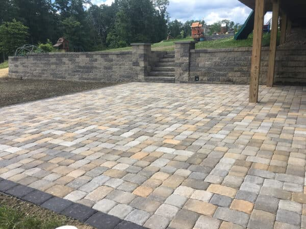 Mulit-Colored Stone Patio with Retaining Wall