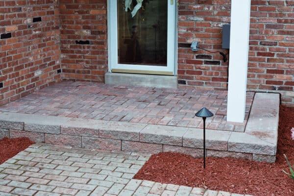 Red Brick Landing with Stone Walkway