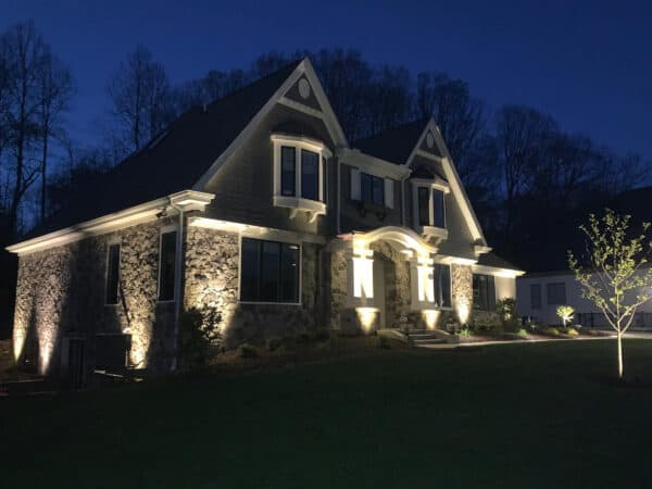 dual peak home with low voltage lighting at night