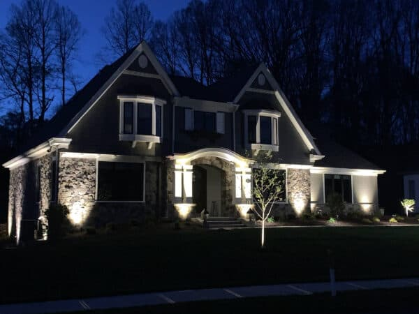 home with low voltage lighting at night